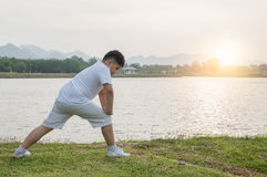 Obese fat boy exercise at park on morning Stock Image