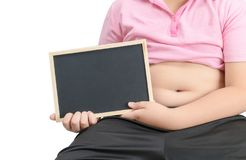 Obese fat boy holding blank blackboard isolated stock photos