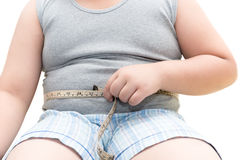 Obese fat boy measuring his belly with measurement tape Royalty Free Stock Photos