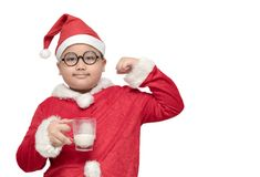 Obese fat boy in santa claus suit holding milk glass. And show muscle isolated on white background, healthy concept Royalty Free Stock Photos