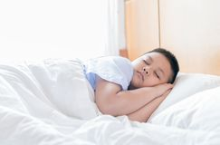 Obese fat boy sleep on bed in morning. Health care concept Stock Photography