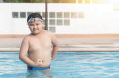 Obese fat boy in swimming pool, concept healthy and exercise Stock Photography
