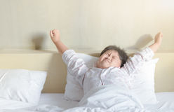 Obese fat boy wakes up and stretching Royalty Free Stock Images