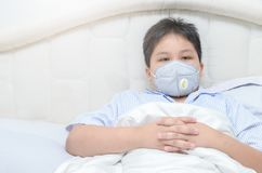 Obese fat boy wearing a dust mask PM2.5 stock images