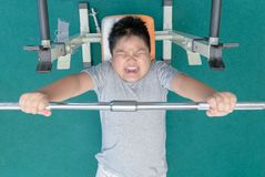 Obese fat boy weightlifting in fitness room,. Exercise to lose weight concept Stock Photo