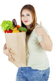 Obese female with paper bag and thumb up Royalty Free Stock Images