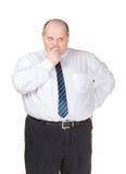 Obese göra en gest för affärsmandanande Arkivfoto