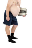 Obese man in the black socks with scales. Overweight man in the black socks stands with weight scales in left hand on a white background Stock Photos