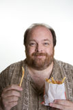 Obese man eating fast food Stock Photos
