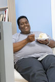 Obese Man Eating Pastry Royalty Free Stock Photo