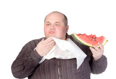 Obese man eating watermelon Royalty Free Stock Image