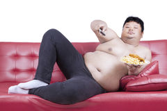 Obese man eats fast food 2 Royalty Free Stock Photos