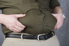 Obese Man Grabbing His Fat On The Stomach Stock Images