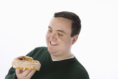 Obese Man Holding Delicious Donut Stock Images