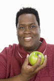An Obese Man Holding Green Apple Stock Photo