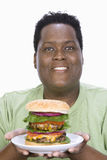 An Obese Man Holding Hamburger Royalty Free Stock Photo