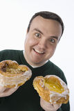 Obese Man Holding Two Donuts Stock Photography