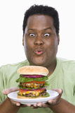 An Obese Man Looking At Hamburger Royalty Free Stock Photo