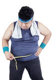 Obese man measuring his belly 2 Royalty Free Stock Photo