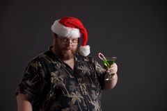 Obese man in Santa Hat Stock Photo