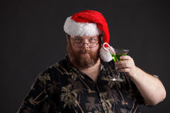 Obese man in Santa Hat Stock Image