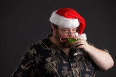 Obese man in Santa Hat Royalty Free Stock Photo