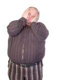 Obese man som plattar till hans framsida Arkivbilder