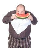 Obese man som äter vattenmelonen Royaltyfri Fotografi