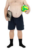 Obese man stands with scales and ball. Obese man in black socks stands with weight scales and yellow-green ball in front of you Stock Image