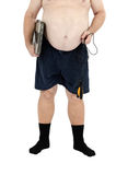 Obese man stands with scales and skipping rope. Obese man stands with weight scales and skipping rope on a white background Royalty Free Stock Image
