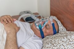 Obese man suffering from sleep apnea Royalty Free Stock Images