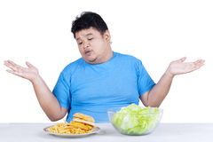 Obese man with two kinds of food Stock Images
