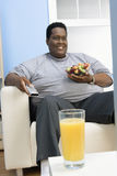Obese Man Watching Television Royalty Free Stock Photography