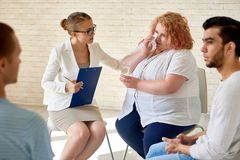 Obese Patient at Group Therapy Session Stock Photo