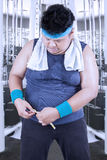 Obese person measure his belly after workout royalty free stock photos