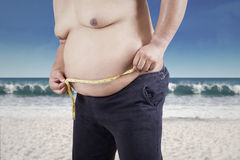 Obese person measuring his belly Stock Images