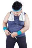 Obese person measuring his waistline Stock Photo