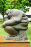 Obese Thinker Sculpture Stock Photo