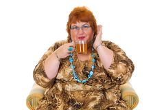 Obese woman. Self confident obese middle aged woman having tea. Studio, white background Stock Images