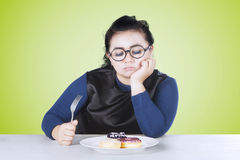 Obese woman bored with donuts Royalty Free Stock Photos