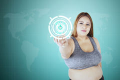 Obese woman click start button with 2017. Obese woman click start button with text diet 2017 on the virtual screen Royalty Free Stock Photos