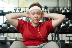 Obese Woman Doing Energetic Weight loss Workout to Music Stock Photography