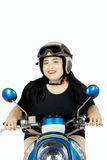Obese woman driving motorcycle Royalty Free Stock Images