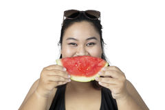 Obese woman eating watermelon. Obese woman eating a slice of fresh watermelon, isolated on white background Royalty Free Stock Images