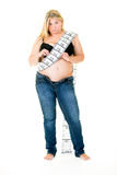 Obese woman with long tape measure around body Royalty Free Stock Photo