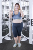 Obese woman with OK sign at gym Royalty Free Stock Photos