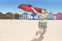Obese woman running at coast Stock Image