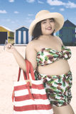 Obese woman with swimsuit at coast Royalty Free Stock Photography