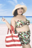 Obese woman with swimsuit at shore Royalty Free Stock Photos