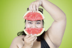 Obese woman with watermelon Stock Photo